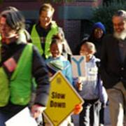 Rep. Byron Rushing (right) joins Hurley families for International Walk-to-School Day