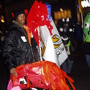 Codman Academy student with SRS banner and mask